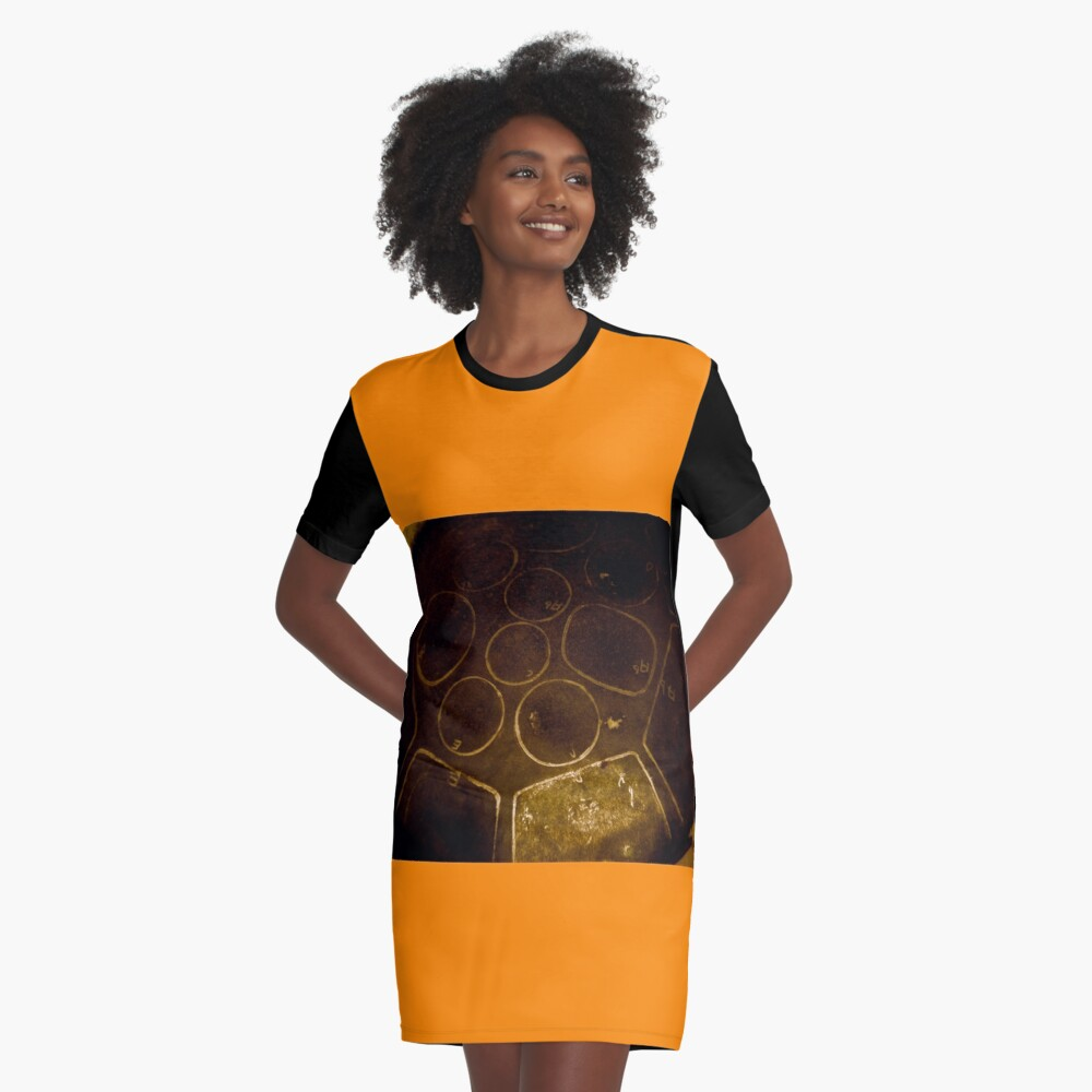 Woman wearing a steel pan dress steel drum